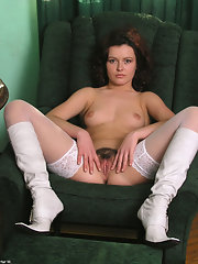 Chubby longhaired older babe shows pussy and clit