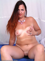 Oiled plump older mom exposes her massive boobs